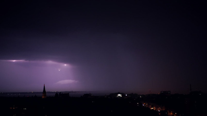 Night stormy sky above city. Set of beautiful lightning strikes. Thunderstorm clouds. Timelapse. Bad weather, meteorology, forecast concept.Slow motion. High quality footage. Royalty-Free Stock Footage #1054648430