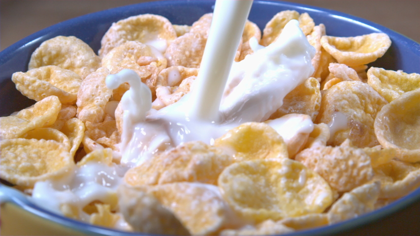 Milk Pouring into a Bowl of Cereal Splashing in Slow Motion Shot at 1000 fps | Shutterstock HD Video #1054671176