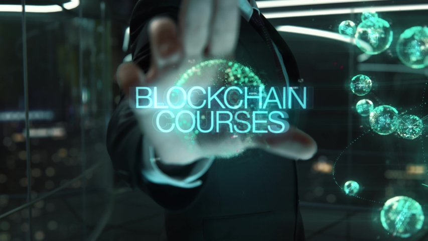Blockchain Courses chosen by businessman in technology hologram concept | Shutterstock HD Video #1054675937