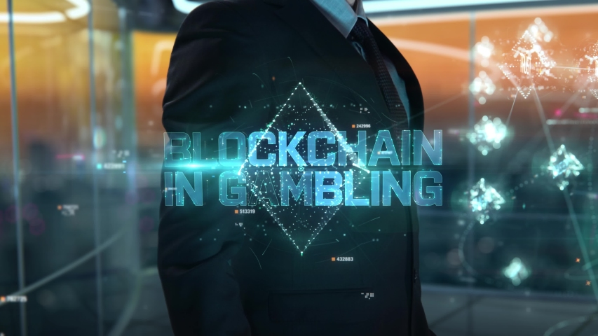 Blockchain in Gambling chosen by businessman in technology hologram concept | Shutterstock HD Video #1054679369