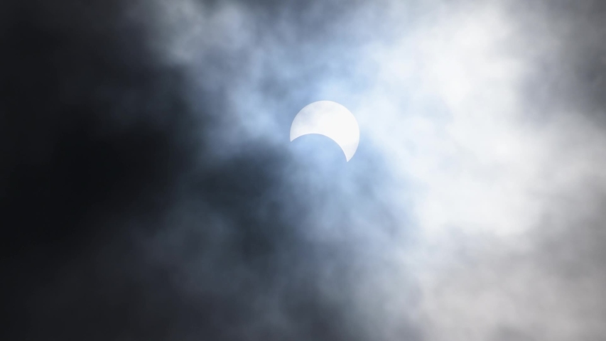 Bhuj, Gujarat, India - 21st June 2020: View of the partial solar eclipse in the sky   Shutterstock HD Video #1054681751