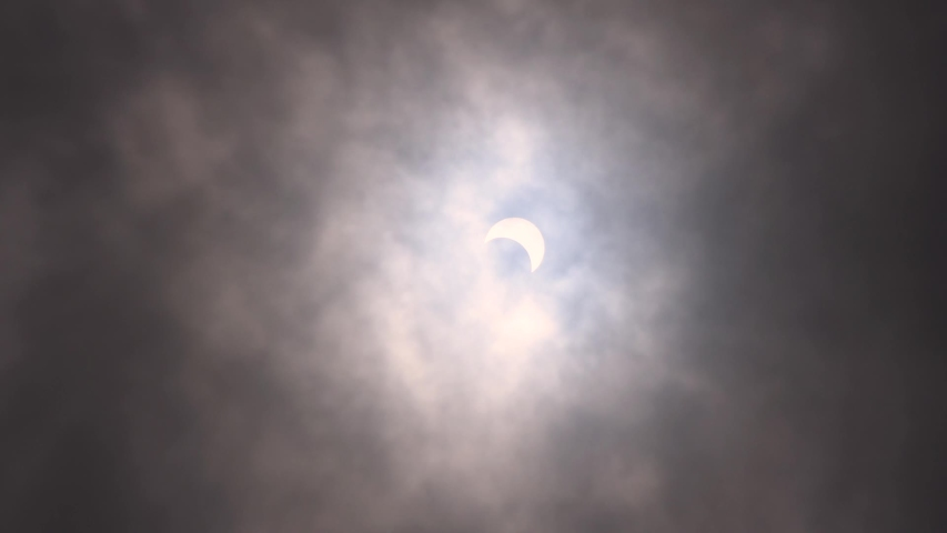 Bhuj, Gujarat, India - 21st June 2020: View of the partial solar eclipse in the sky   Shutterstock HD Video #1054681754