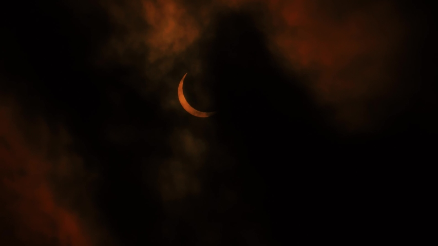 Solar Eclipse Partial. Getting covered by clouds. Foreboading dramatic sky. Near full eclipse. 21st June 2020. Hong Kong, Asia.   Shutterstock HD Video #1054685087