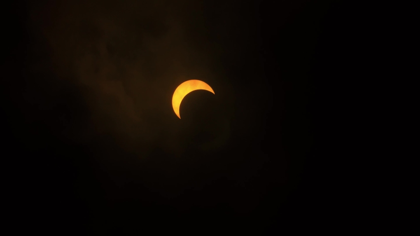 Solar Eclipse Partial. Getting covered by clouds. 21st June 2020. Hong Kong, Asia.   Shutterstock HD Video #1054685090