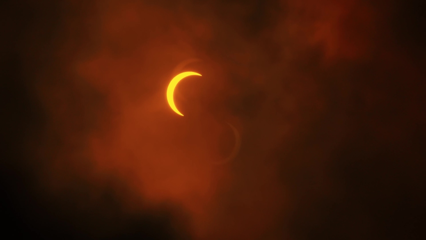 Solar Eclipse Partial. Getting covered by clouds. Dramatic. Near full eclipse. 21st June 2020. Hong Kong, Asia.   Shutterstock HD Video #1054685099