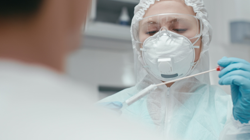 Hospital female employee at laboratory room closeup. PCR sampling for corona virus test by medicine nurse with glasses indoors. Medical equipment for covid-19 sickness cure at doctor scientific office Royalty-Free Stock Footage #1054685687