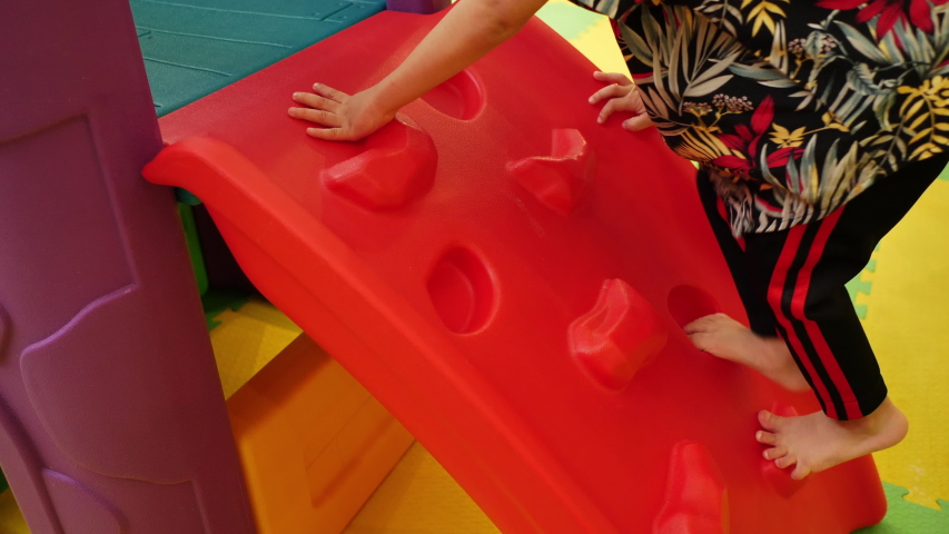 Slow motion, child boy playing climb in house playground | Shutterstock HD Video #1054685774