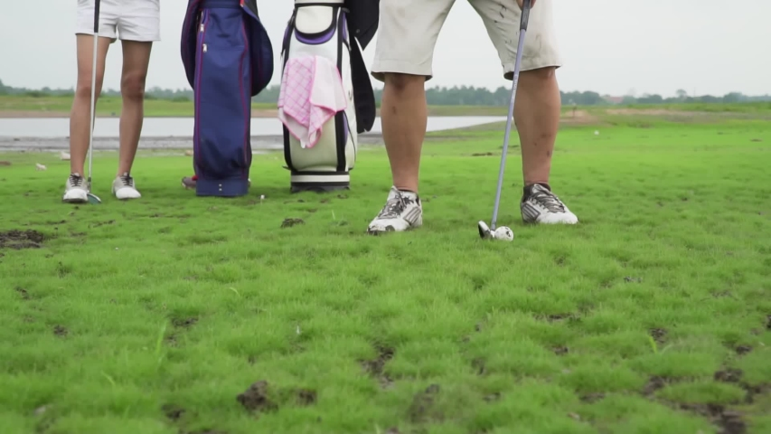 Footage B Roll of couple lover in action of playing golf together. Golf ball away from the rough to fairway, Difficult time stay together in the family course. Golf Rehearse in nature fields.