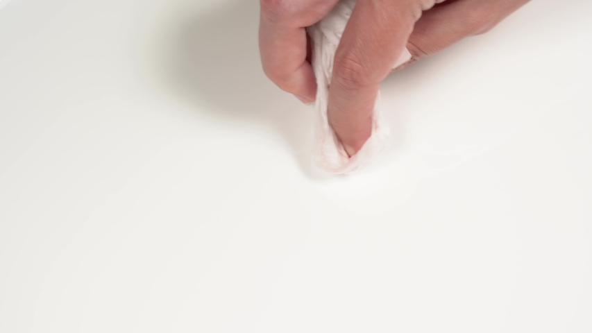 Female hand cleaning white dirty surface with paper tissue | Shutterstock HD Video #1054694012