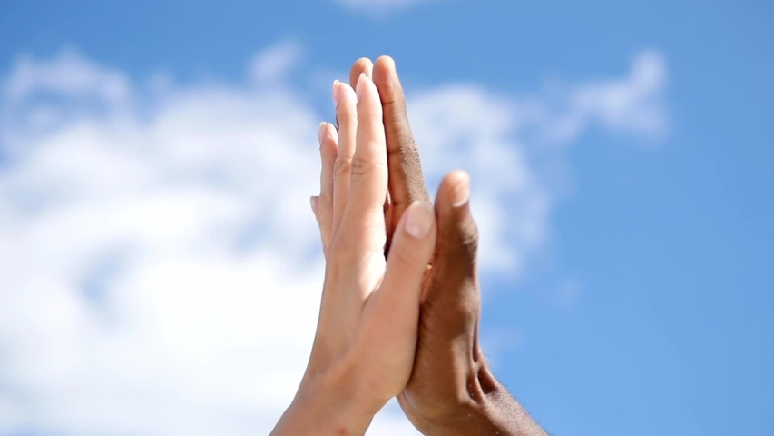 Friendship, anti-racism, fraternity-white hand and black hand are given the five. Stop racism, all people are equal. White and black hand connect. Friendship of Peoples. BLW. Black lives mater | Shutterstock HD Video #1054695785