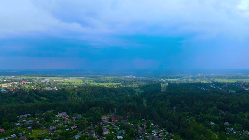 Lightning on a summer day aerial view. Rainy summer landscape. Lightning bolt aerial video   Shutterstock HD Video #1054697567