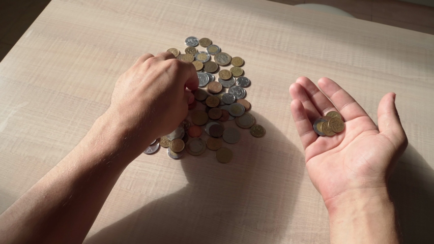 A guy finds small coins. Little money. Poverty and debts. Crisis. Close-up. POV video. | Shutterstock HD Video #1054698167