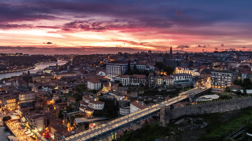 Magnificent Sunset, Aerial View Shot of Porto, Oporto, Dom Luis I Bridge, Douro River, Old Town, Portugal Royalty-Free Stock Footage #1054698503