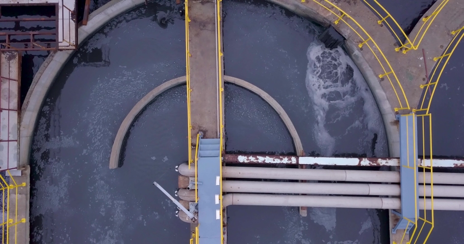 Aerial view above Water circle pool with pumping station in Gujarat, India. Purified drinking water supply. Purification and treatment facilities. Industrial wastewater cleaning infrastructure