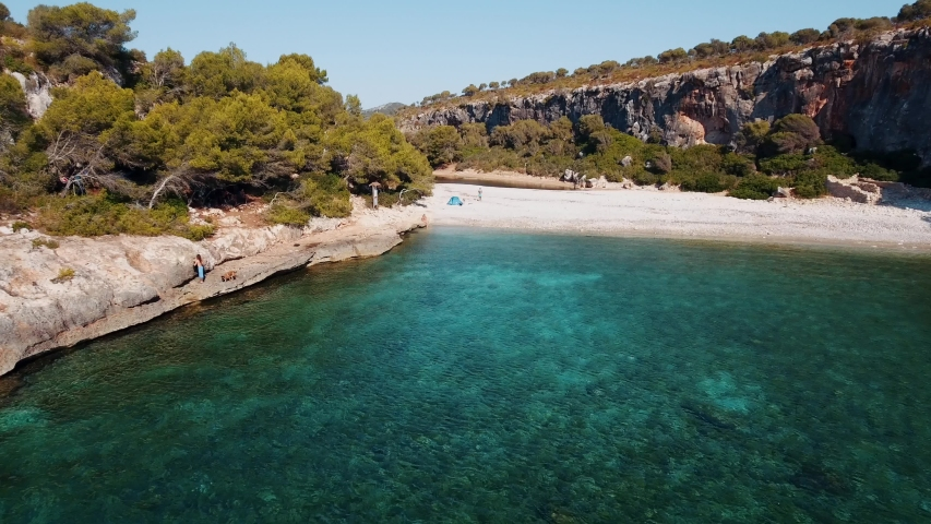 Beautiful aerial shot in 4k of a beautiful bay with turquoise clear water in Mallorca Spain.   Shutterstock HD Video #1054698905