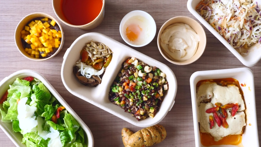Healthy Food Delivery in White Recycling Paper Eco Boxes. Dinner with Tomato Soup, Vegetables, Green Salad, Low Calorie Lasagna and Bread. Concept of Takeaway Diet Food from Restaurant. Top View Royalty-Free Stock Footage #1054699217
