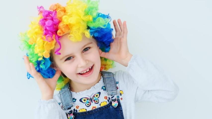 School child in colorful wig | Shutterstock HD Video #1054699649
