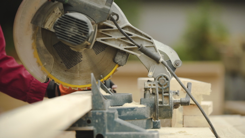 Slow Motion Close Up of Table Saw Cutting Wood on Construction Site | Shutterstock HD Video #1054701143