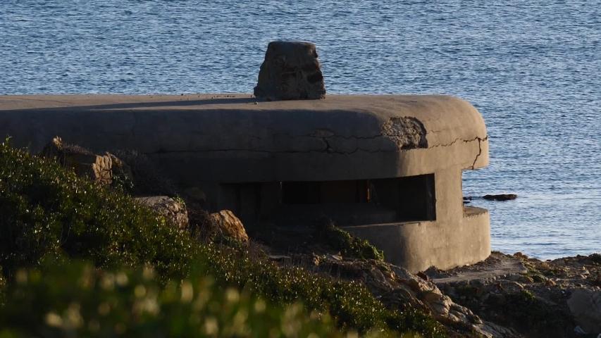Spanish coastline. War bunker on Torrecarbonera beach, Punta Mala, Andalusia Spain.