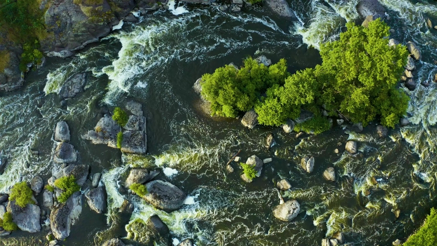 Swirling streams of a mountain river with a rocky shore and forest, a close-up view from a drone, national treasure of nature in the Urals. Russia.