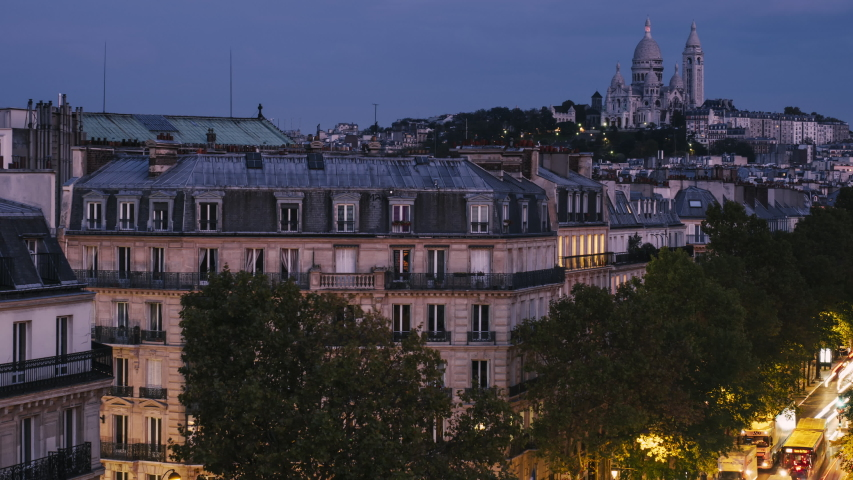 High view of Sacre Coeur with traffic on street below, Paris, France. Dawn to day time lapse | Shutterstock HD Video #1054701983