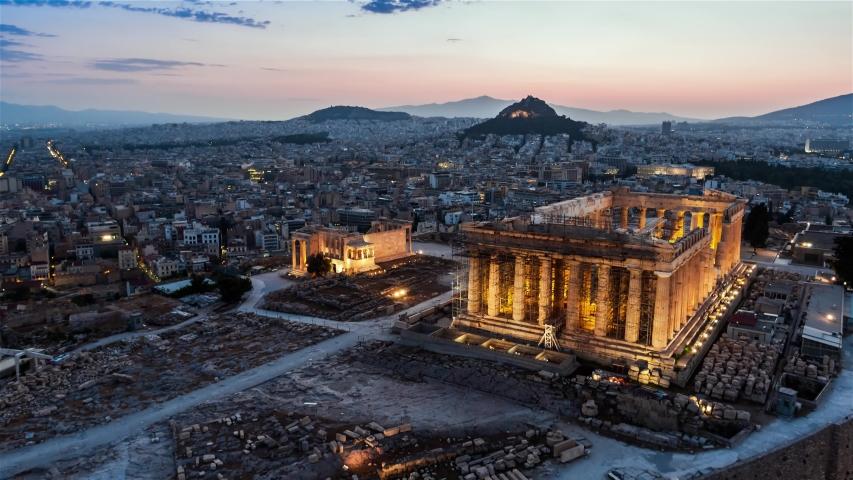 Aerial View Shot of Athens, ancient Parthenon, Acropolis, Greece at dawn dusk