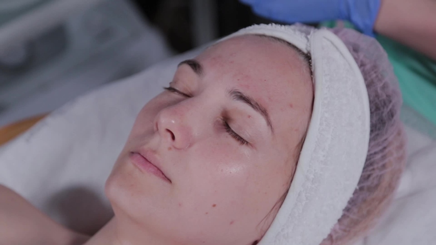 Beautiful woman lies on a couch in a beauty parlor. | Shutterstock HD Video #1054702463