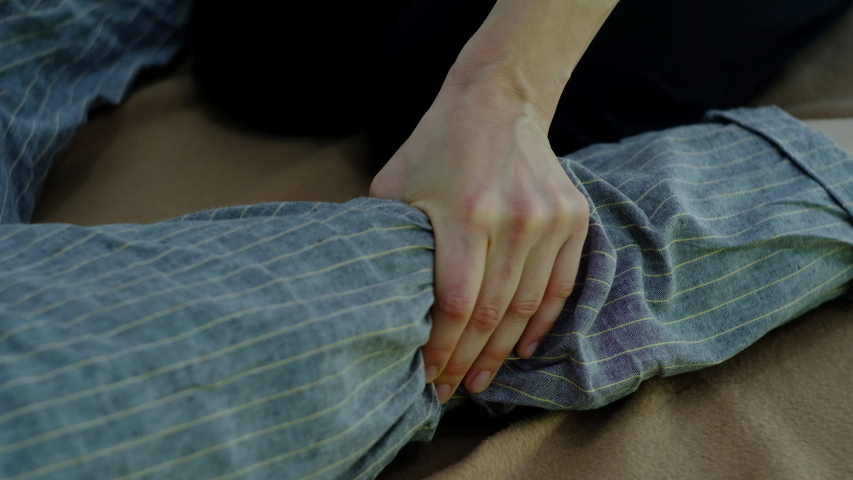 Master of Thai massage performs exercises for massage and relaxation the legs | Shutterstock HD Video #1054703879