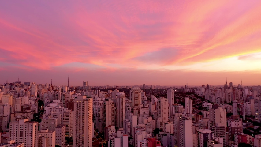 Colorful Exotic Sky. Panoramic landscape of sunset in City Life Scene Landscape. Sao Paulo, Brazil. Aerial Landscape. Cityscape. Aerial View of São Paulo. Colorful Sky. Colored Sky. Sky Sunset City.