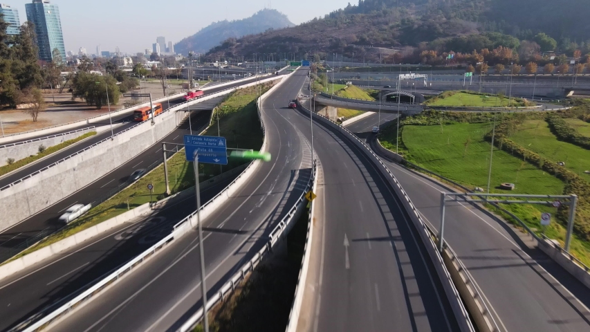 Aerial flying directly above highway and moving forward at low altitude, Santiago, Chile-4K | Shutterstock HD Video #1054704644