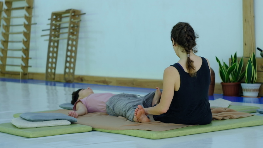 Master of Thai massage, performs exercises for massage and relaxation the legs. | Shutterstock HD Video #1054705946