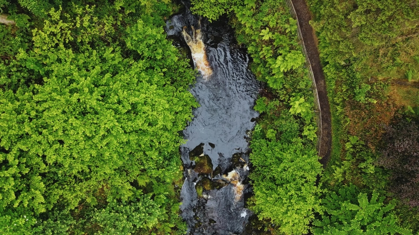Aerial view of waterfall & river at Glenariff Forest Park, Northern Ireland - 4K   Shutterstock HD Video #1054706237