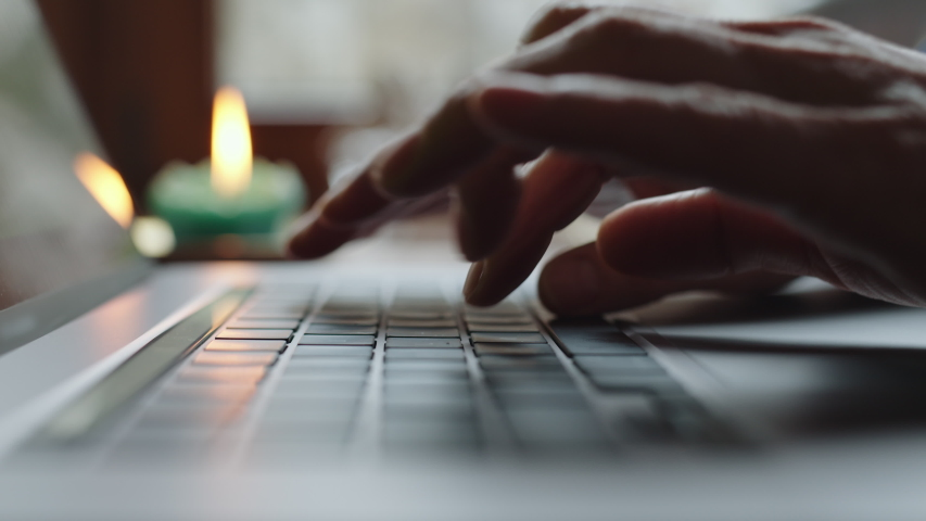 Mature woman hands typing on notebook keyboard in slow motion. Closeup unrecognizible businesswoman work on laptop at remote office. Successful business woman browsing internet on laptop computer at Royalty-Free Stock Footage #1054708343