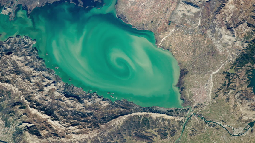 Lake aerial satellite view with scenic water vortex zoom in Lake Skadar Montenegro Europe. Images furnished by Nasa | Shutterstock HD Video #1054708829