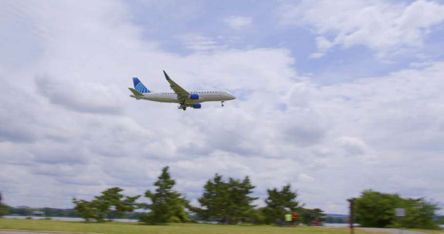 Washington, DC - June 19, 2020: United Airlines UAL Embraer ERJ 170 Jet Airliner Flies Over Gravelly Point Park Final Approach Ronald Reagan National Airport DCA Sunny Day blue sky white clouds audio