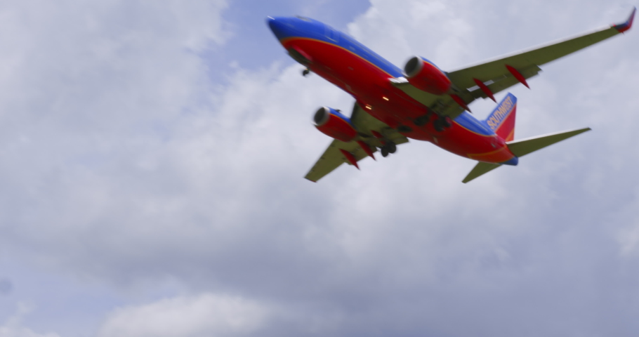 Washington, DC - June 19, 2020: Southwest Airlines SWA 737 Passenger Jet Airliner Flies Over Gravelly Point Park Final Approach Ronald Reagan National Airport DCA Sunny Day blue sky white clouds audio