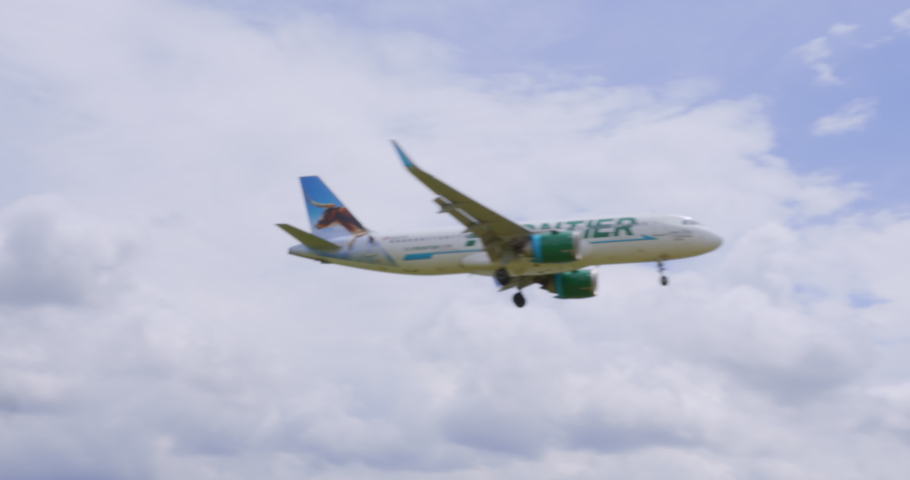 Washington, DC - June 19, 2020: Frontier Airlines FFT Airbus 320 Jet Airliner Flies Over Gravelly Point Park Final Approach Ronald Reagan National Airport DCA Sunny Day blue sky white clouds audio