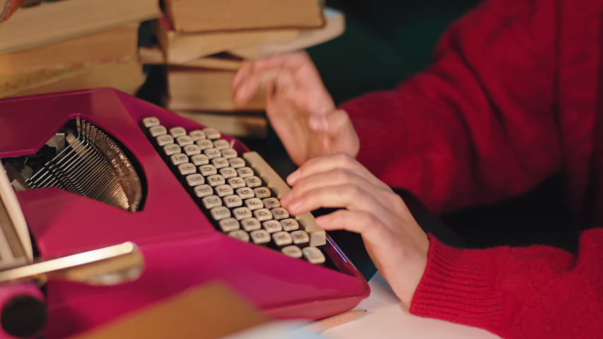 Details pink typewriter lady typing something on the machine in the library | Shutterstock HD Video #1054710584