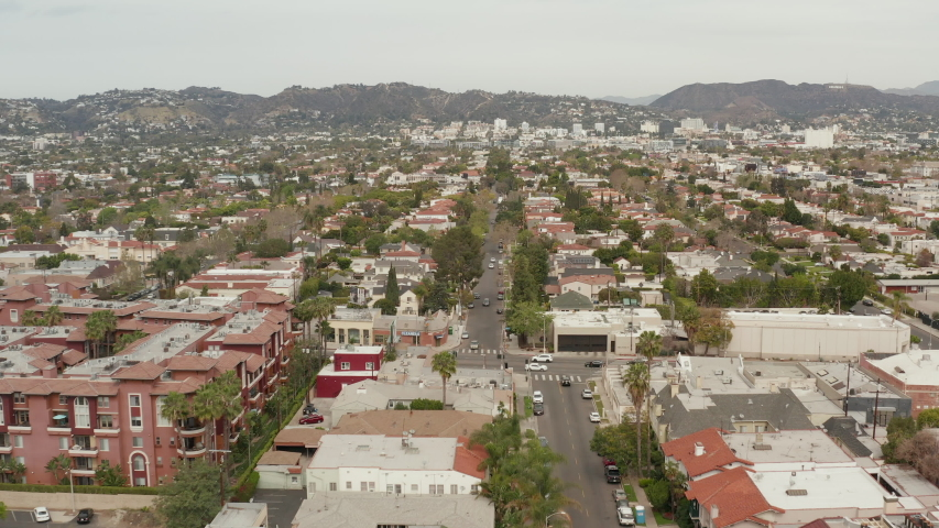 AERIAL: Typical Houses , Apartments , Residential Area in West Hollywood, California with Beautiful Rich colors in Trees and Buildings