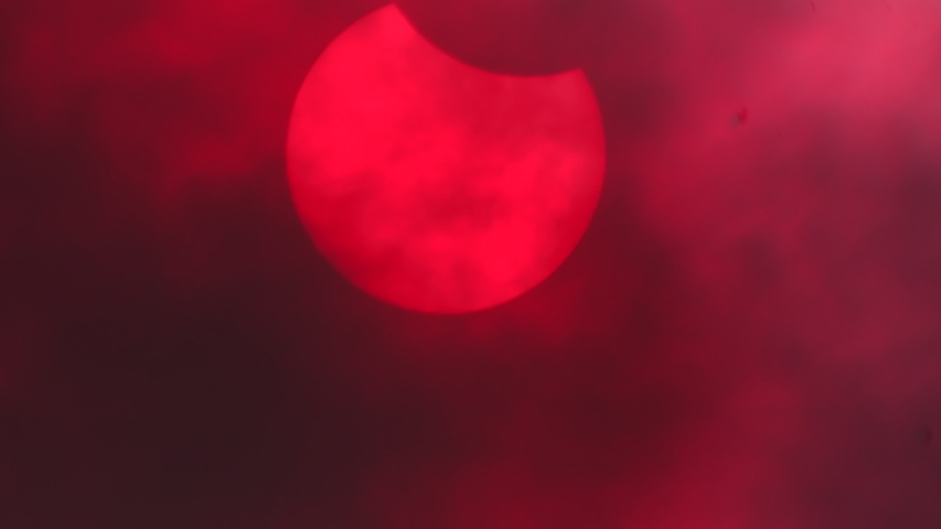 Partial Solar Eclipse and Cloud movement in Chiangmai, Thailand.   Shutterstock HD Video #1054712888