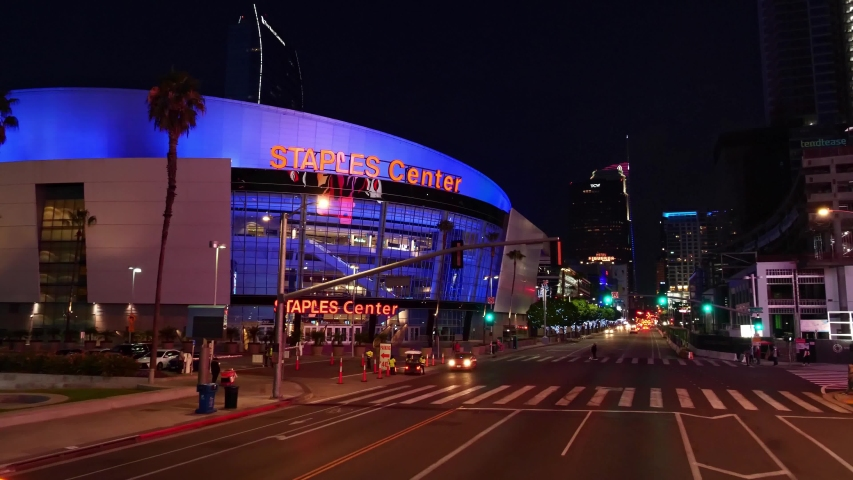 LOS ANGELES, CA, USA - JUNE 5, 2020: Establishing aerial drone shot of skyscrapers buildings street in downtown Los Angeles at night. Staples center. Concept of American modern urban city lifestyle