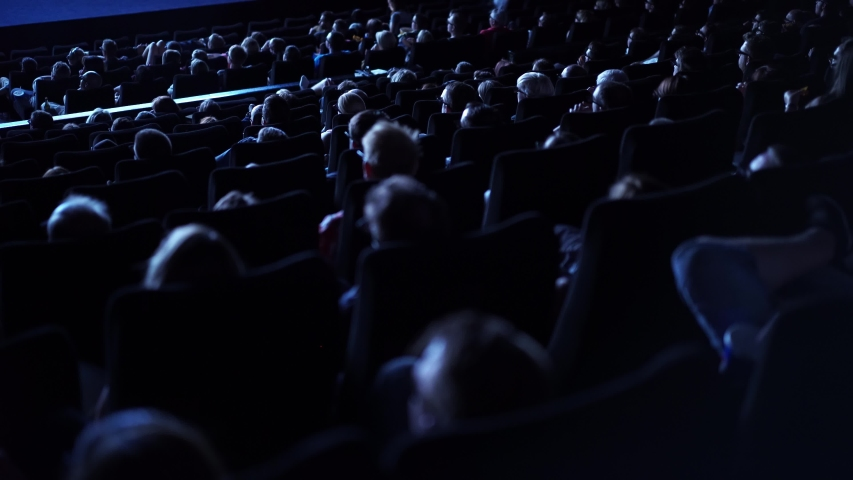 Audience in a movie theater during a film performance - cinema | Shutterstock HD Video #1054718597