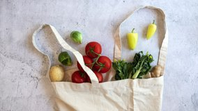 grocery vegan product gathering on the reusable bag on flat lay design. fresh vegetable shopping  .stop motion video