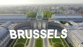 Inscription on video. Brussels, Belgium. Park of the Fiftieth Anniversary. Park Senkantoner. The Arc de Triomphe of Brussels (Brussels Gate). Glitch effect text, Aerial View, Departure of the camera
