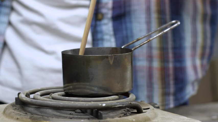 Man Stirs Linseed Oil With A Wooden Stick. The Process Of Manufacturing Impregnation For A Wood Of Beeswax, Rosin. Homemade Pastewax, Ganozis. Water-Repellent Impregnation For Wood And Stone. | Shutterstock HD Video #1054719737