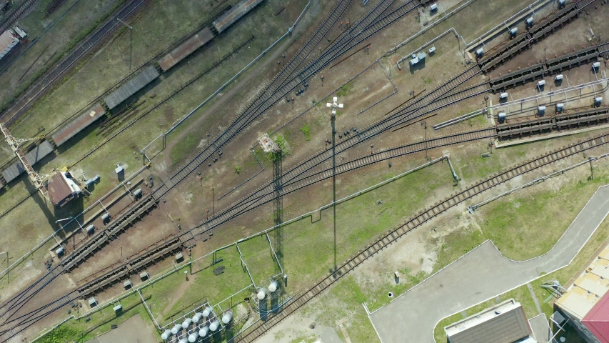 Rail interchange yard, view from top vertically downwards. A large transport hub for making up trains. | Shutterstock HD Video #1054721153
