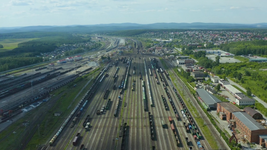 Flight over the branches of railway tracks and a panoramic view of the large transport hub of the marshalling yard. | Shutterstock HD Video #1054721162