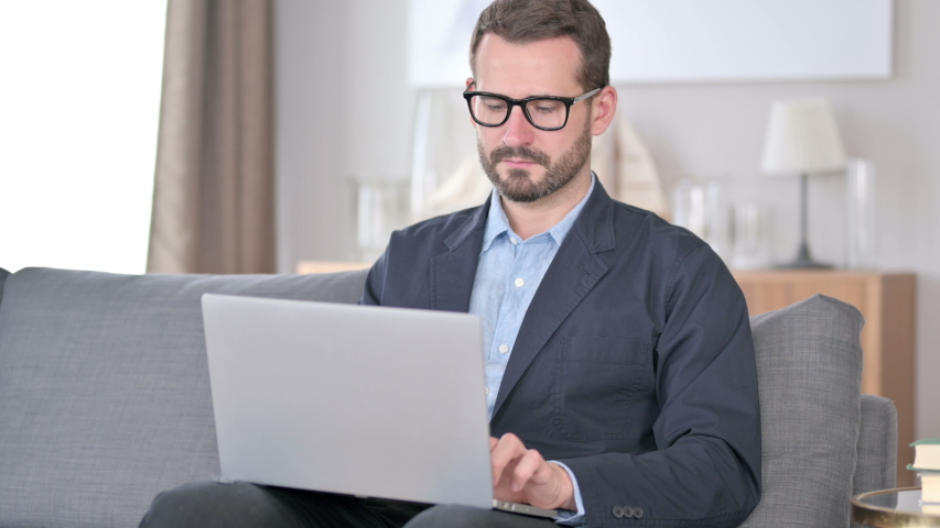 Young Businessman using Laptop at Home  | Shutterstock HD Video #1054722668
