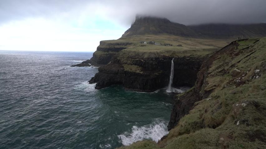 Mulafossur Waterfall near Gasadalur village on the coastal of Vagar Island, The Faroe Islands. | Shutterstock HD Video #1054722866