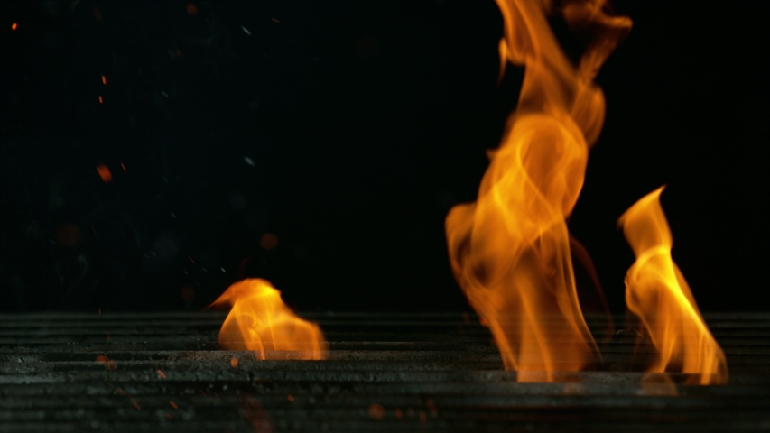 Super slow motion of empty grill grid with fire on black background. Filmed on high speed cinema camera, 1000 fps | Shutterstock HD Video #1054724102